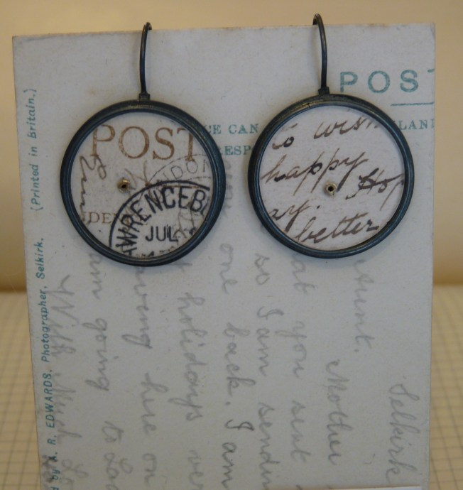 Earrings with large circles of postcards (25m across) was £90 / now £45