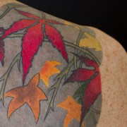 Detail - Tiger full back tattoo with leaves, seaweed and waves