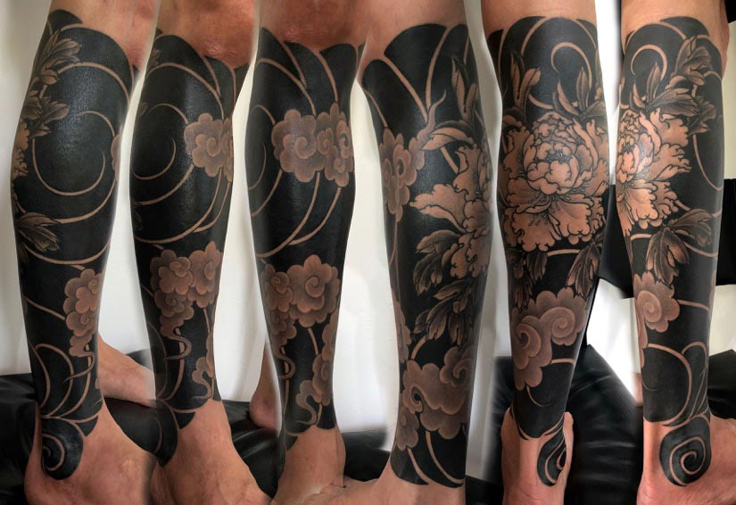 Peony tattoo cover up by Clare Keton
