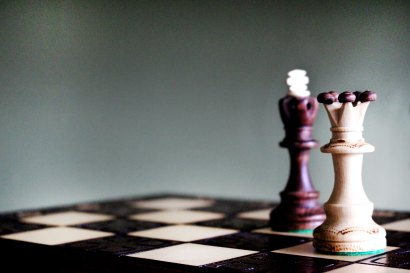 two chess pieces on a chess board