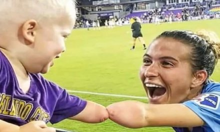 Heartwarming photo captures 'fist' bump between toddler and pro soccer player with matching limb difference