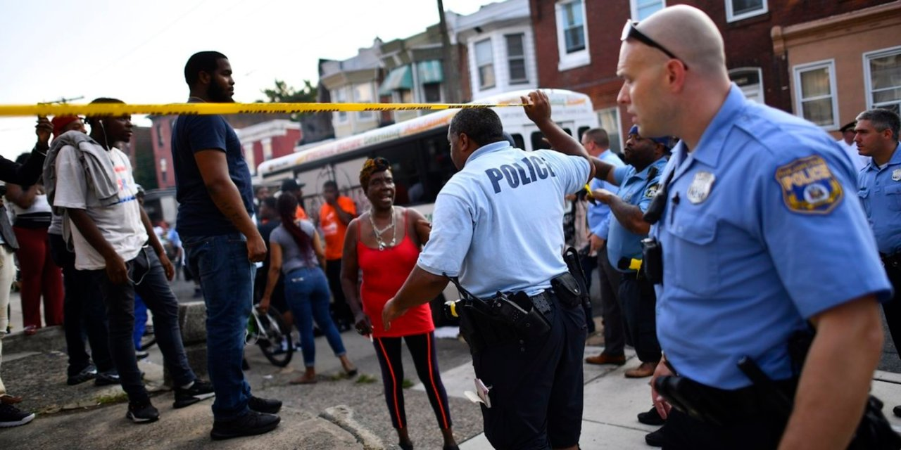 Philadelphia bystanders taunted and laughed as police officers were being fired upon
