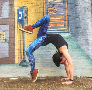 wheel yoga pose in downtown rock island in werkshop leggings