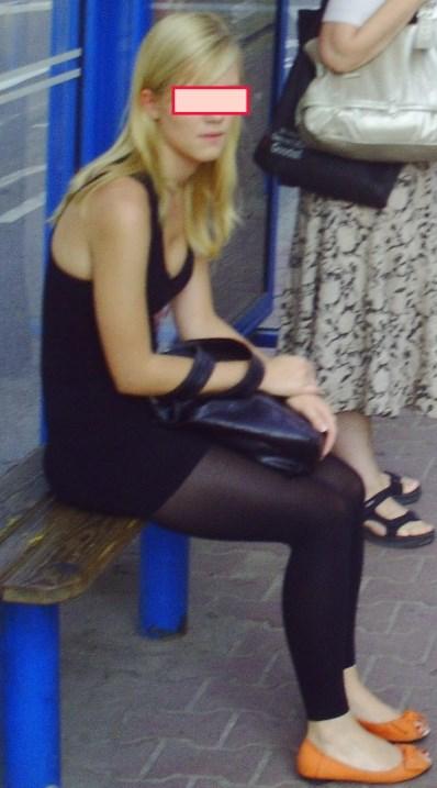 Swedish lady sitting at a train station