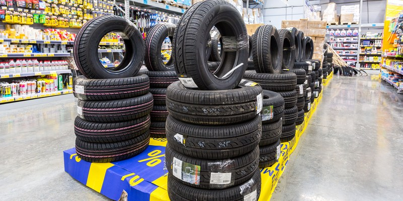 Brand new tires stacked up for sale in the chain hypermarket