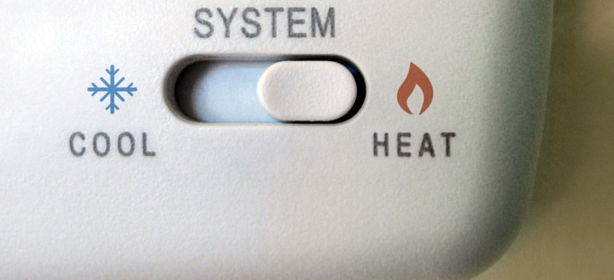 Thermostat set to heat home