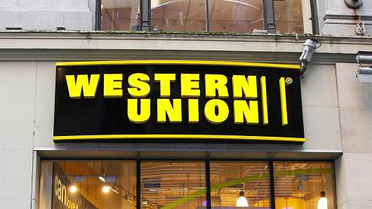 Western Union agrees to pay $586M after agents helped thieves process fraud payments