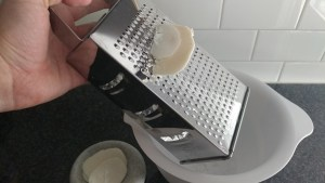 Grate bar soap to begin the process of making liquid hand soap