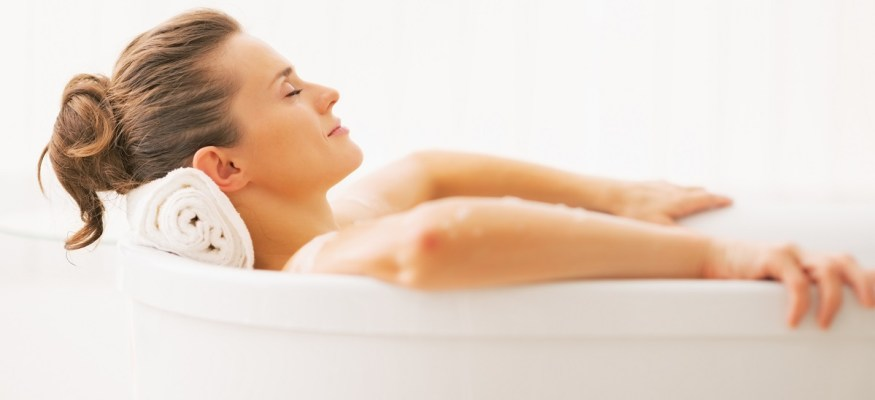 Woman taking a hot bath