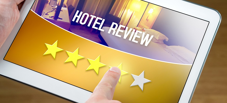 Good hotel review. Satisfied and happy customer giving great rating with tablet on an imaginary criticism site, application or website. Four out of five stars to accommodation or lodging.