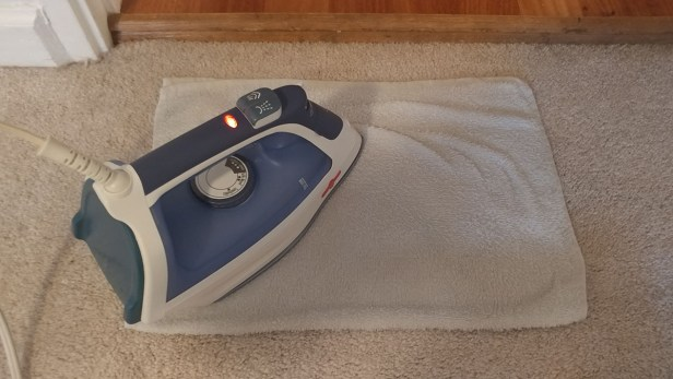 Step 3: Set iron to medium heat and apply it to the towel, moving the iron over the stain for about 15 seconds. Using high heat may burn the carpet!