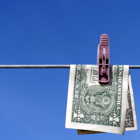 Dollar bill hanging on clothes line