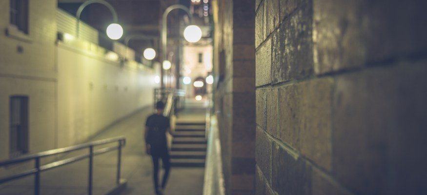 Man walking down dark street