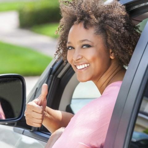 Woman buying a car (via Dreamstime)