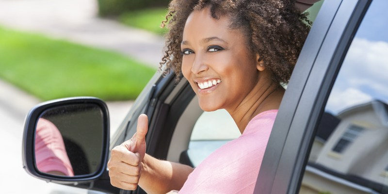 Woman buying a car (via Dreamstime)