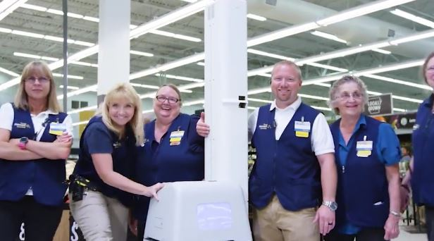 Walmart employees with shelf-scanning robot