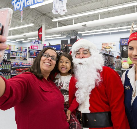Santa Claus poses for selfie with Walmart shoppers
