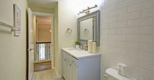 Remodeled bathroom with white tile