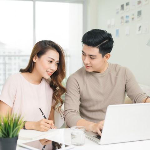 Couple analyzing bills