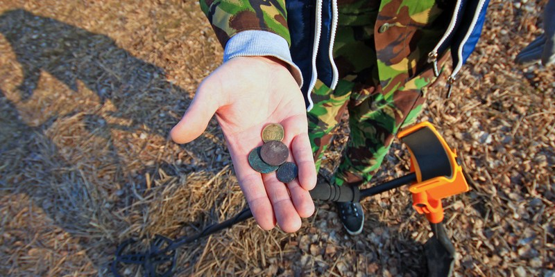 metal detector man with old coins
