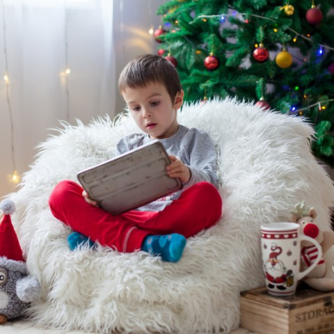 child playing with tablet during christmas