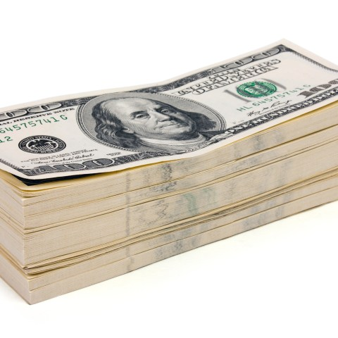 How to find out about class action lawsuits - Stack of money ($100 bills)