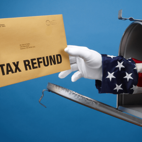 Man receiving tax refund in the mail from Uncle Sam