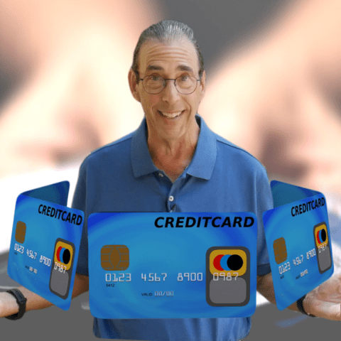 Clark Howard surrounded by a circle of blue credit cards with his hands out by his side