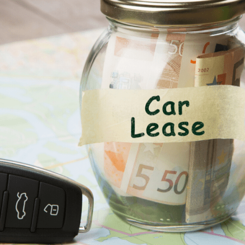 Car finance concept - money glass with word Car lease, car key.
