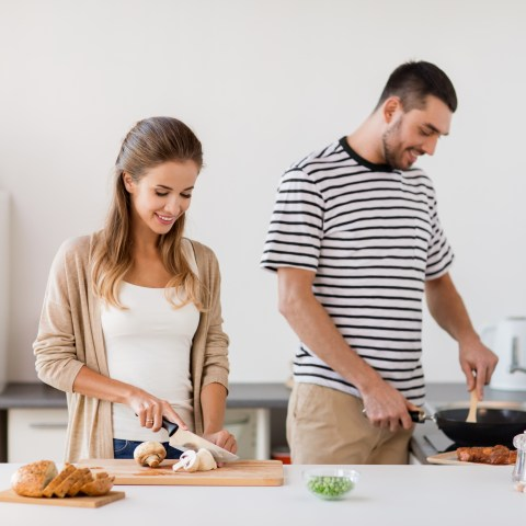 Couple cooking food at home