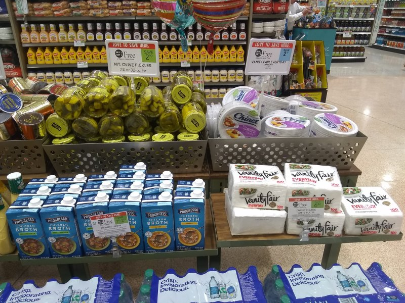 Mt. Olive pickles, Vanity Fair napkins and other Publix BOGO items at the front of the store
