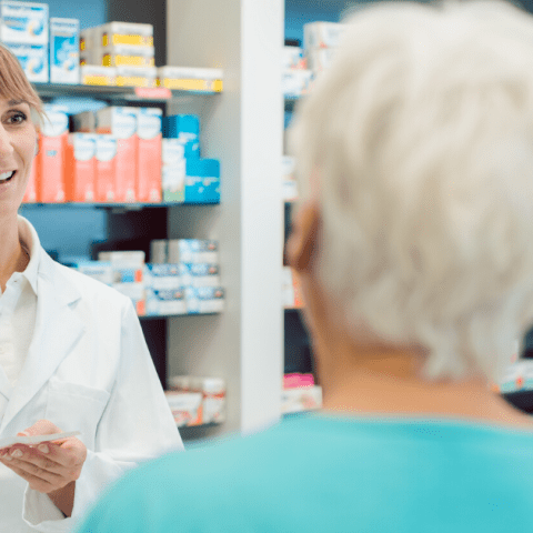 Pharmacist talking to senior citizens about drug costs