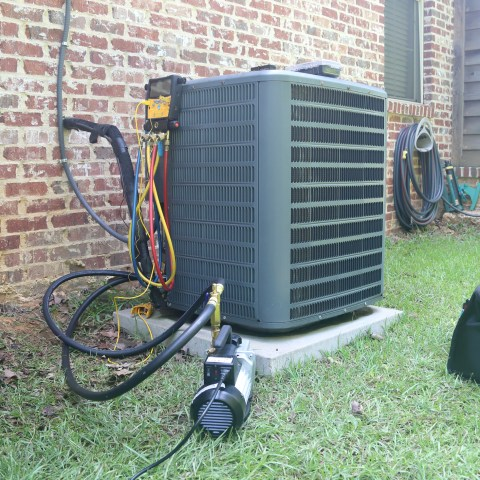 Should I replace or repair my broken air conditioning system?