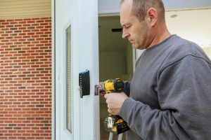 Man replacing door for home remodeling project