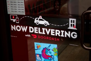 now delivering with doordash sign at a wendy's restaurant