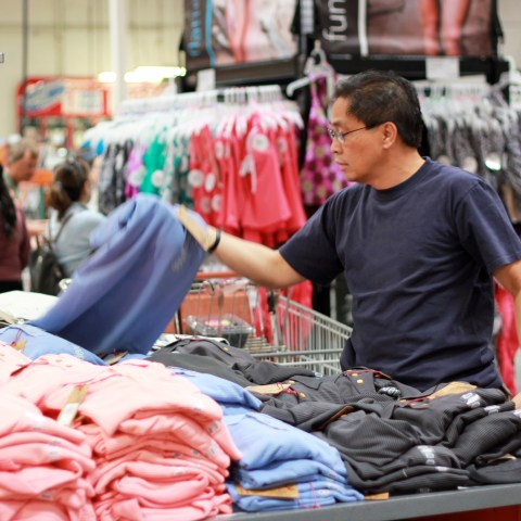 Man shopping for Costco clothing at the warehouse club