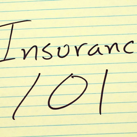 insurance 101 written on a yellow legal pad