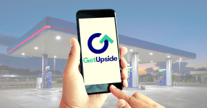 GetUpside app being used in front of a gas station.