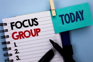 focus group written on notepad