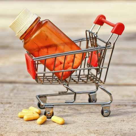 Medical pills and jar in shopping cart.