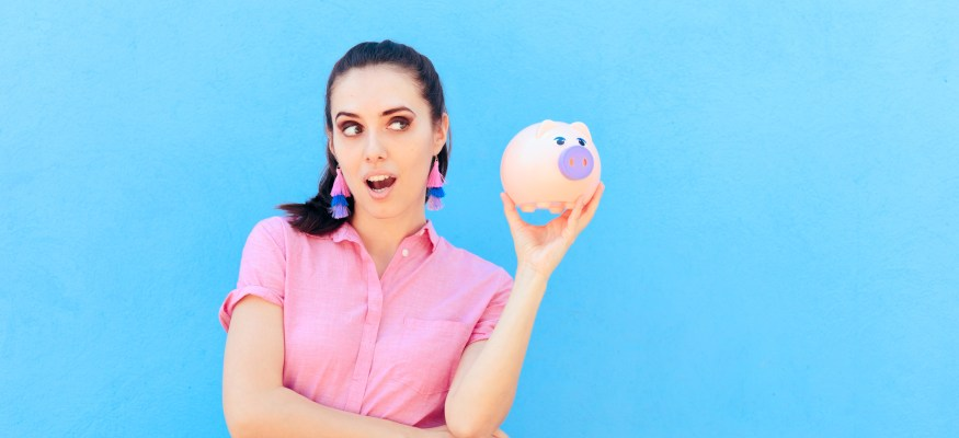 young woman with piggy bank via dreamstime