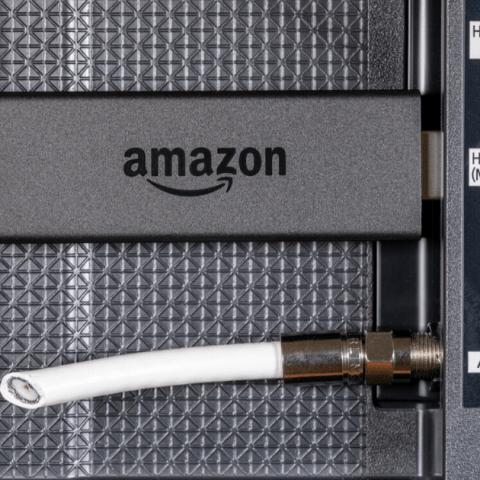 Amazon Fire TV Stick plugged into a TV.