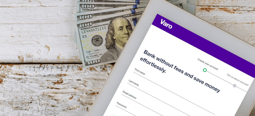 Varo Bank on tablet sitting on $100 bills