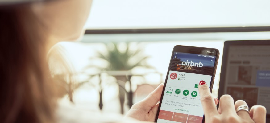 Woman booking Airbnb