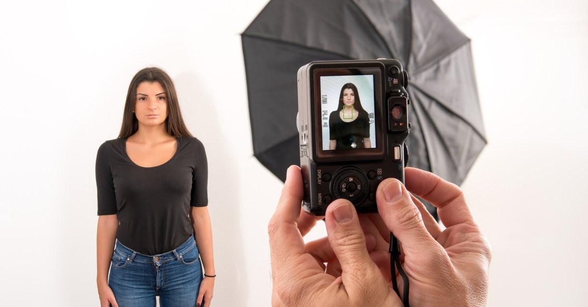 Woman getting passport photo taken