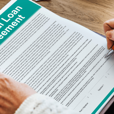 Personal loan agreement being signed by woman