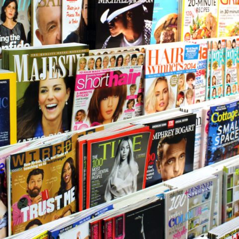 Magazines on a display stand in a store