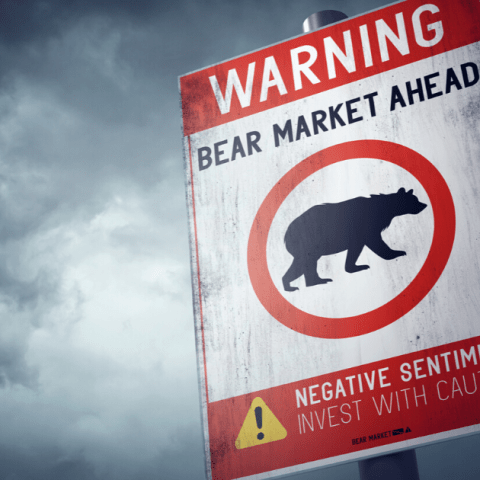 traffic sign that reads 'warning bear market ahead'