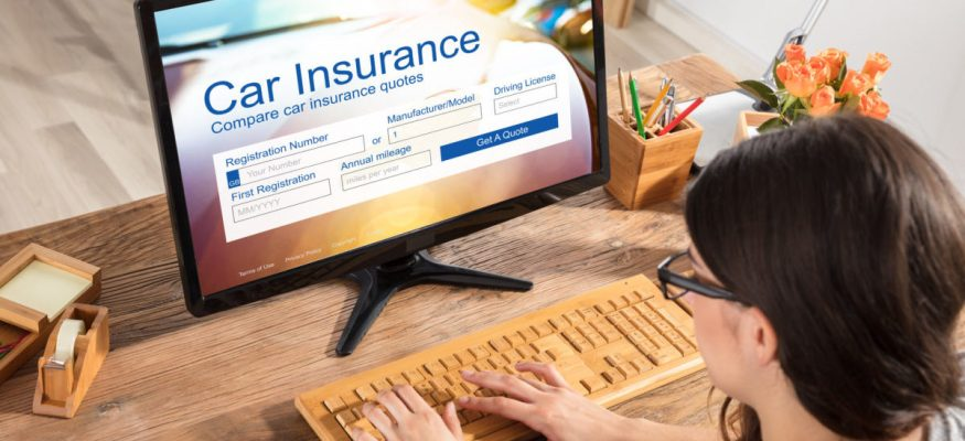 A woman shopping for car insurance online