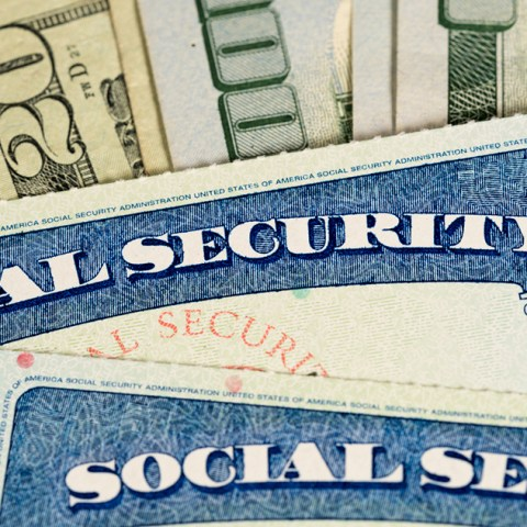 Social Security cards and $100 bills